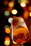 Wine. Glass of wine with a background of city lights Stock Image