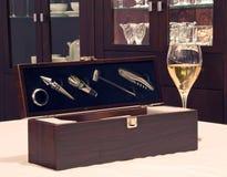 Wine accessories with wine glass. White wine in glass with wine accessories in the box stock photos