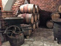Wine aging in barrels in a cellar Stock Photography