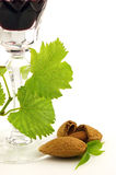 Wine and amande. Red wine with almond on a white background royalty free stock photos
