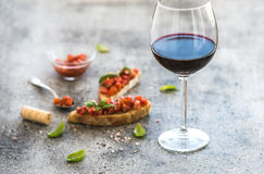 Wine appetizer set. Glass of red wine, brushettas Stock Photography