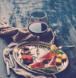 Wine appetizer set. Glass of red wine, vintage Royalty Free Stock Image