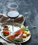 Wine appetizer set. Glass of red wine, vintage Stock Photos