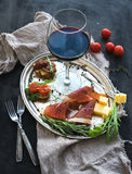 Wine appetizer set. Glass of red wine, vintage Stock Image