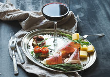 Wine appetizer set. Glass of red wine, vintage Stock Images