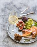 Wine appetizer set. Glass of white wine, honeycomb Stock Image
