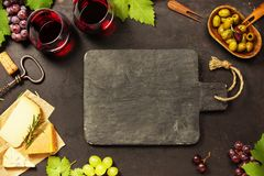 Wine appetizers set: French cheese selection, grapes and walnuts stock images