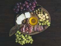 Wine appetizers set: meat and cheese selection, honey, grapes, w Royalty Free Stock Photography