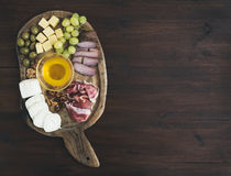 Wine appetizers set: meat and cheese selection, honey, grapes, w Stock Photo