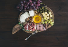 Wine appetizers set: meat and cheese selection, honey, grapes Stock Photography