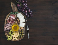 Wine appetizers set: meat and cheese selection, honey, grapes Stock Photo