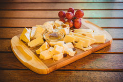 Wine appetizers. On a wooden plate and table Royalty Free Stock Image