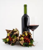 Wine and autumn dried wild fruit Stock Photography