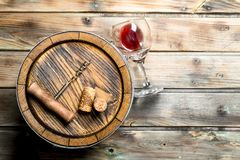 Wine background. Barrel of red wine. On a wooden background royalty free stock photos