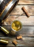 Wine background. Barrel of white wine. On a wooden background royalty free stock images