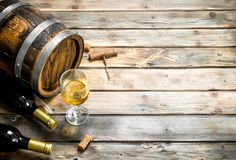 Wine background. Barrel of white wine. On a wooden background stock image