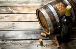 Wine background. Barrel of white wine. On a wooden background stock images