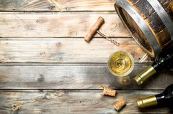 Wine background. Barrel of white wine. On a wooden background royalty free stock photography