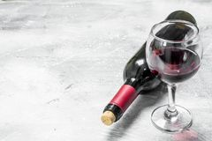 Wine background. A bottle of red wine with a glass royalty free stock photo