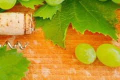 Wine background - cork, grape and leaf Royalty Free Stock Photos
