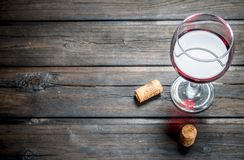 Wine background. A glass of red wine with corks royalty free stock photo