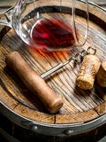 Wine background. A glass of red wine on an old barrel stock photo