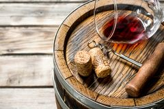 Wine background. A glass of red wine on an old barrel stock photography