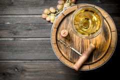 Wine background. An old barrel of white wine stock image