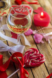 Wine on the background of sweet hearts Royalty Free Stock Photo