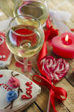 Wine on the background of sweet hearts Stock Image