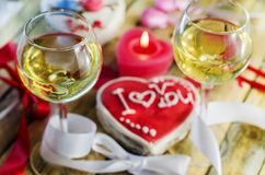 Wine on the background of sweet hearts Royalty Free Stock Photography