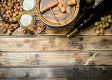 Wine background. White wine in an old barrel. On a wooden background royalty free stock photos