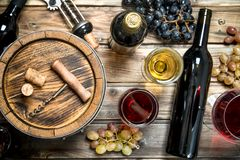 Wine background. White and red wine in glasses stock photography