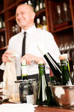 Wine bar bottles waiter in restaurant Royalty Free Stock Photos