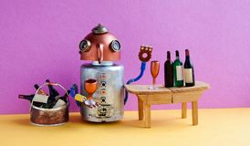 Wine bar party event concept. Funny robot alcoholic drink wine. Creative design copper head cyborg toy gets drunk Stock Images