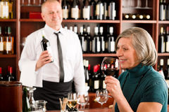 Wine bar senior woman enjoy wine glass Stock Photos