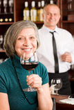 Wine bar senior woman enjoy wine glass Stock Images