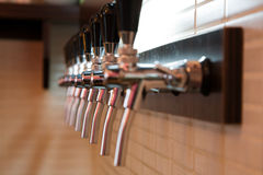 Wine bar-shop. Row of spigots for pouring out wine in wine bar-shop Stock Photo