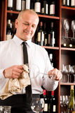 Wine bar waiter clean glass in restaurant Royalty Free Stock Photos