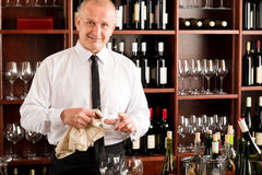 Wine bar waiter clean glass in restaurant Royalty Free Stock Photo