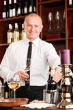 Wine bar waiter happy male in restaurant Stock Photos