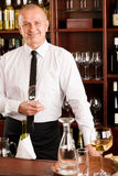 Wine bar waiter happy male in restaurant Royalty Free Stock Photos