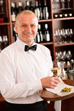 Wine bar waiter mature serve glass restaurant Royalty Free Stock Photography