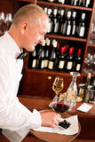 Wine bar waiter mature serve glass restaurant Royalty Free Stock Images