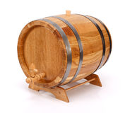 Wine barrel. Handcrafted new oak wine barrel with metalic rings and tap on white background stock photo