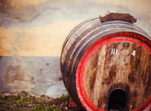 Wine  barrel against a stone wall Stock Images