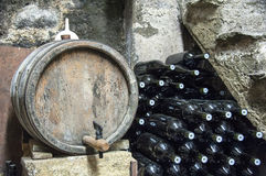 Wine barrel and bottles stock images