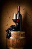 Wine on barrel in cellar. With clay wall stock images