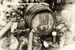 Wine barrel and dried meat assortment in vintage setting Stock Photos