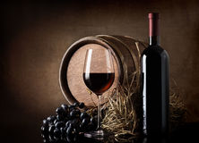 Wine with barrel and hay. Wine with wooden barrel, hay and grape royalty free stock photography
